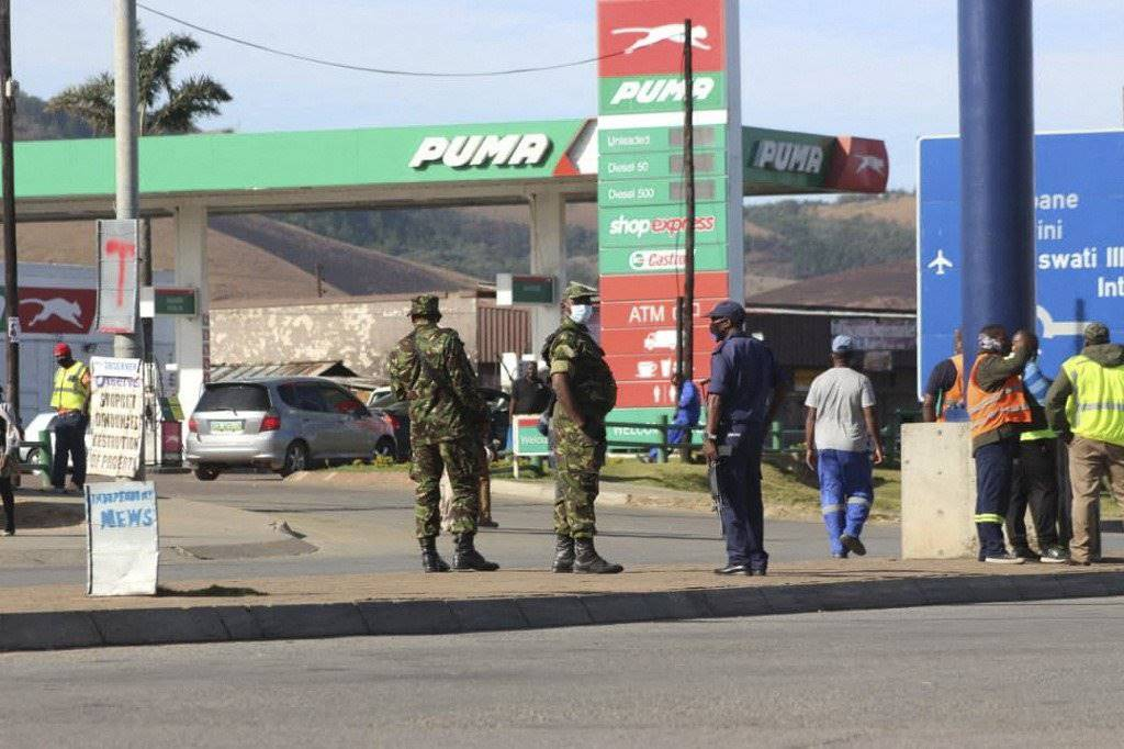 Eswatini soldiers and policemen stand guard in the streets near the Oshoek border post between Eswatini and South Africa. Photo: AFP