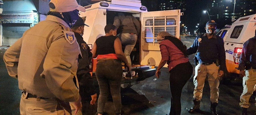 At least 20 people were arrested on Sunday night as police tried to restore calm in the Johannesburg inner city.