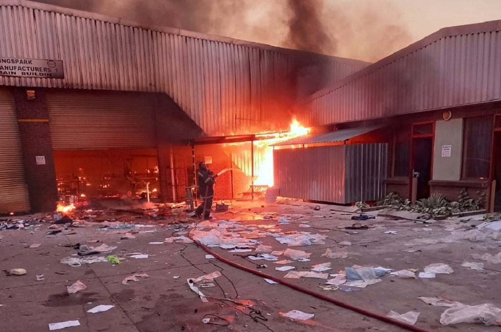A Kingspark Manufacturers factory was set alight after it was looted. (Photo: Supplied by Jason Walters-Girout).