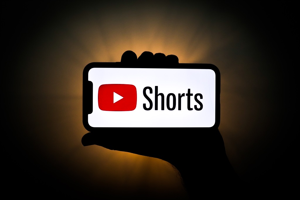 YouTube Shorts logo is seen displayed on a phone s