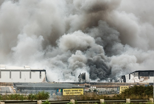 Smoke rising from a Makro building which was set on fire in Umhlanga, north of Durban during riots earlier this month.