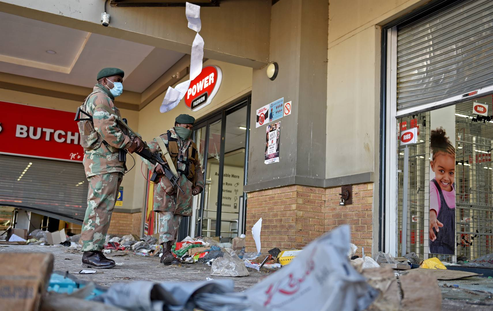 Soldiers patrol the looted and vandalized Diepkloof Square in Soweto. Photo: Tebogo Letsie/City Press