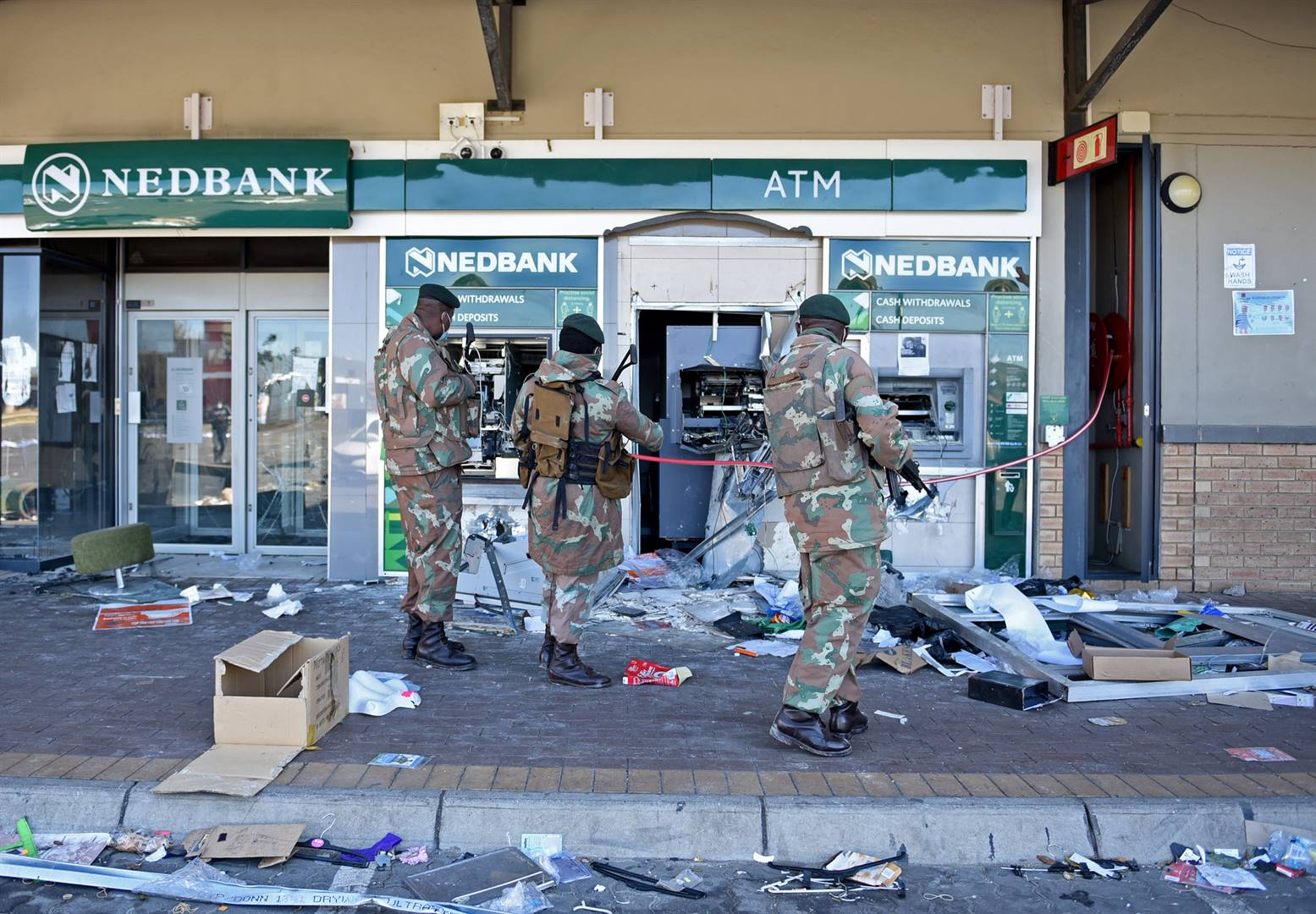 ATM machines were pulled out of the wall by looters at Diepkloof Square in Soweto.