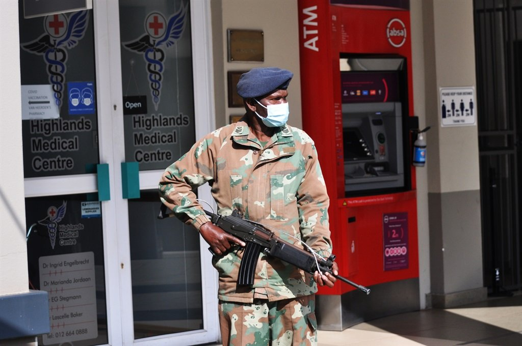 South African National Defence Force (SANDF) members patrol Highlands Shopping Centre.
