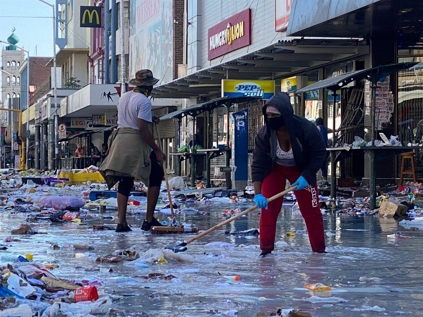 Durban taxi rank drivers and community members clean the streets in Durban central.