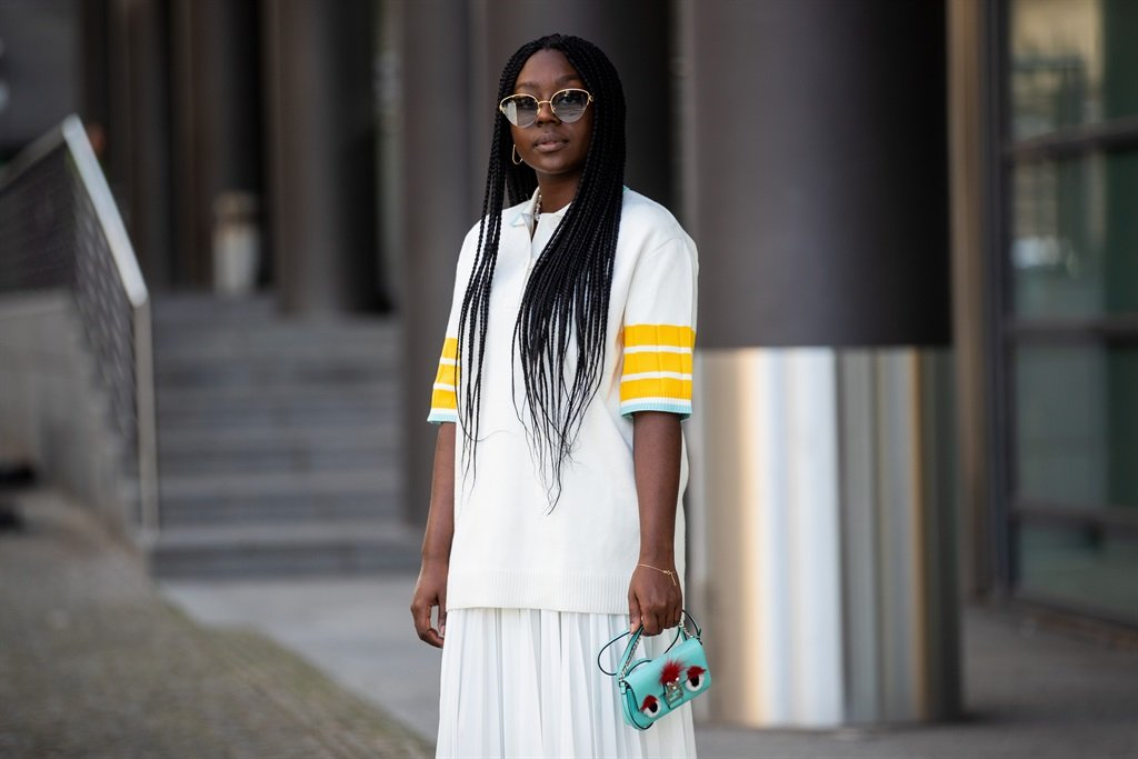Lois Opoku is seen wearing white polo and skirt Lacoste, Fendi bag in Berlin, Germany. (Photo by Christian Vierig/Getty Images)