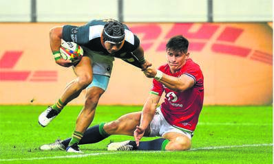 Cheslin Kolbe of South Africa 'A' and Louis Rees-Zammit of the British & Irish Lions during the tour match at Cape Town Stadium on Wednesday.