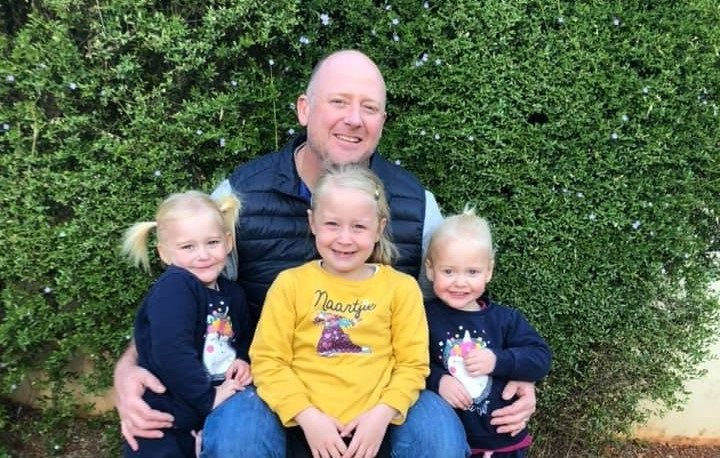 Graham Dickason with his daughters.