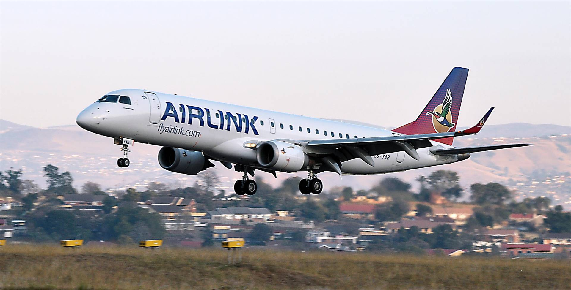 The Airlink plane carrying relief food parcels lands at Oribi Airport on Sunday.
