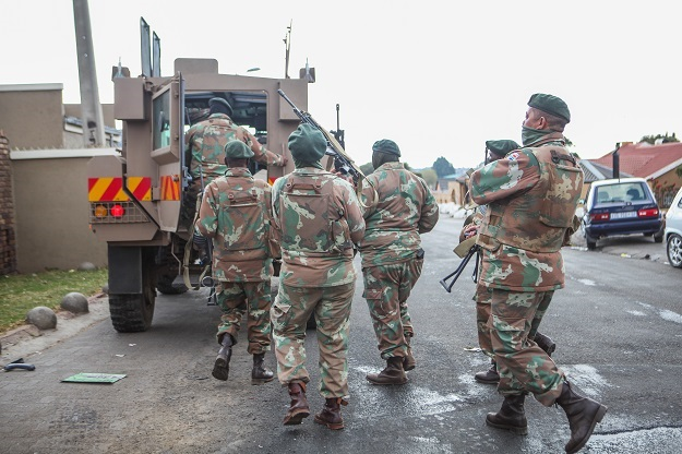 SANDF members patrol the streets in Alexandra amid the unrest in the country.