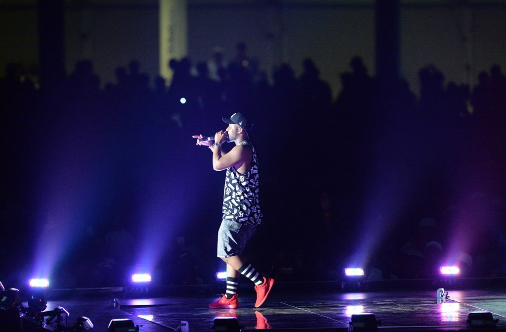 Cassper Nyovest performs during Cassper Nyovest's Fill Up The Dome concert on October 31, 2015 at the TicketPro Dome in Johannesburg, South Africa. Nyovest, real name Refiloe Phoolo, is set to make history by being the first local artist to fill up the 20 000 seater venue. (Photo by Gallo Images / Frennie Shivambu)