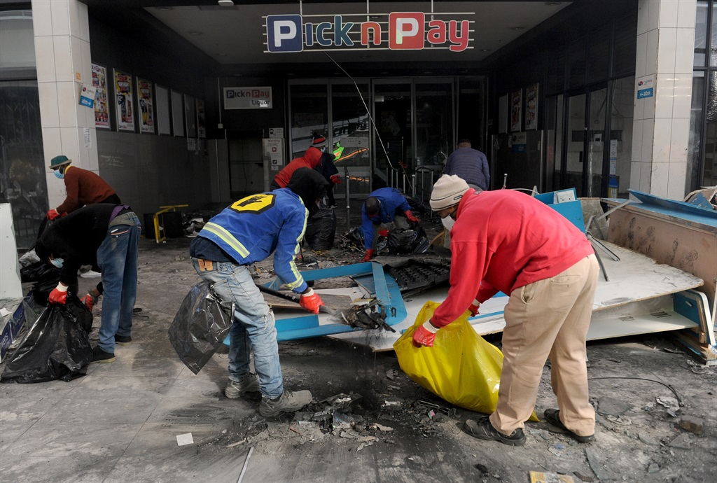 Alexandra township residents embarked on a clean up of Pan Africa shopping centre which was looted and vandalized last week and left the mall completely unrecognisable with almost nothing to salvage. Photo: Tebogo Letsie