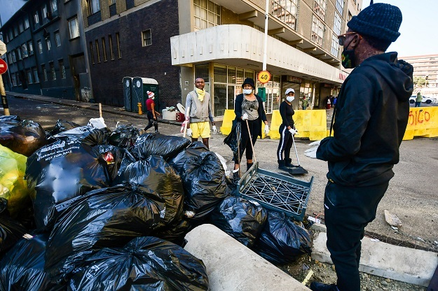 Mangosuthu University of Technology students take part in a cleaning up efforts in Durban.