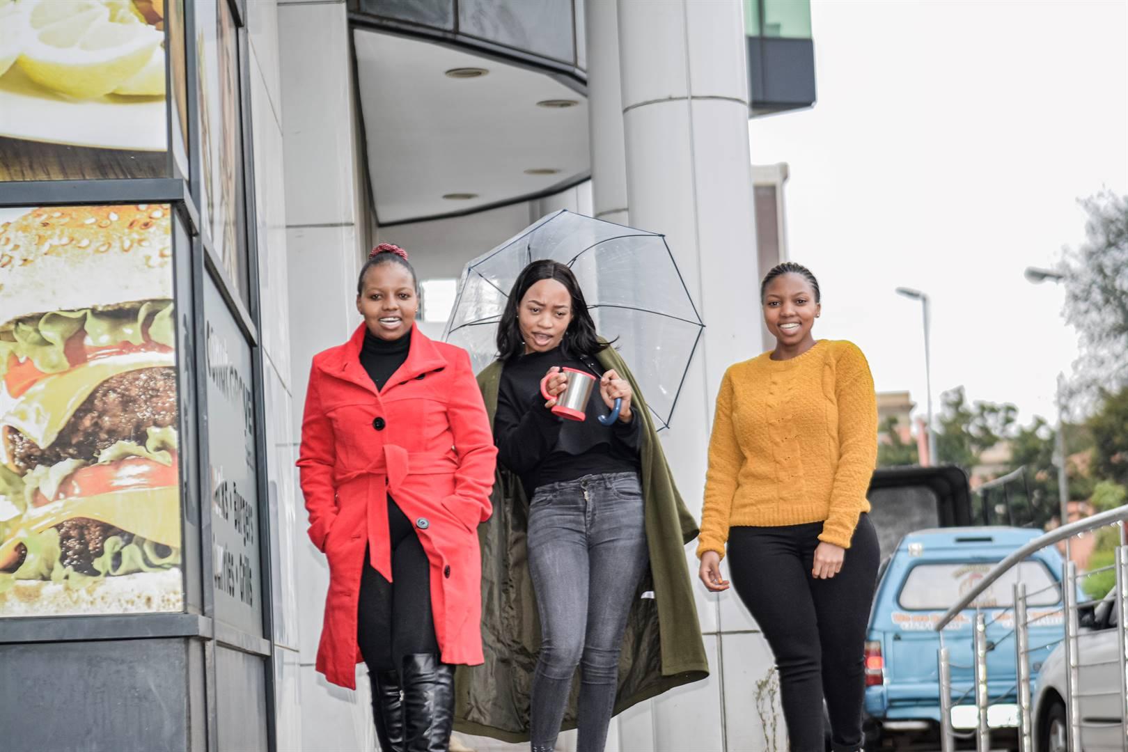 Thabile Maphalala, Xolile Sibiya and Ntando Dlamini enjoyed their lunch break in the cold weather in the Pietermaritzburg CBD yesterday.