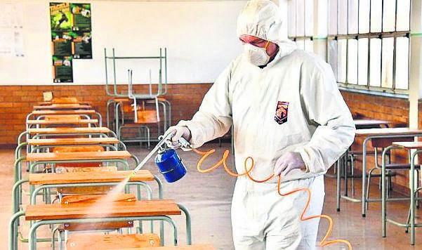A worker sanitises a classroom at a Johannesburg school.