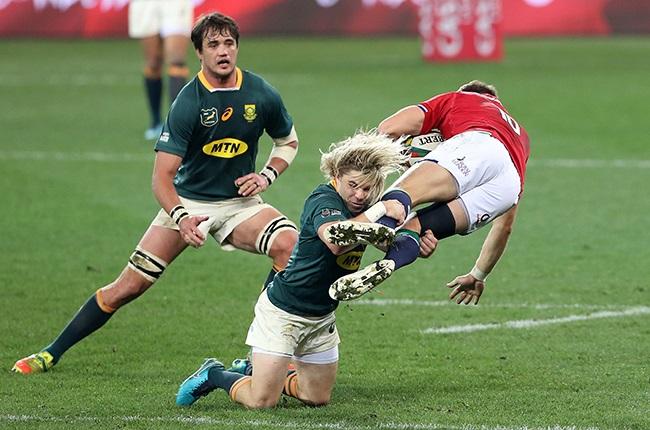 Faf de Klerk of the Springboks tackles Dan Bigger of the Lions (Gallo)