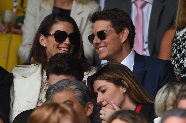 Earlier this month Tom Cruise and his Mission Impossible co-star Hayley Atwell and were seen smiling and chatting while taking in the action at the Wimbledon tennis finals. (PHOTO: ABACA / Magazine Features)