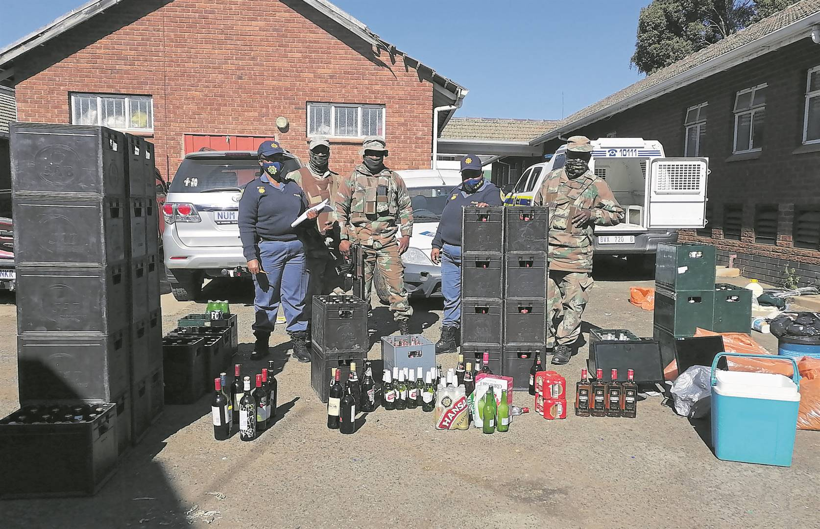 Members of the SANDF 4 South African Infantry Battalion and Greytown police with some of the recovered loot.