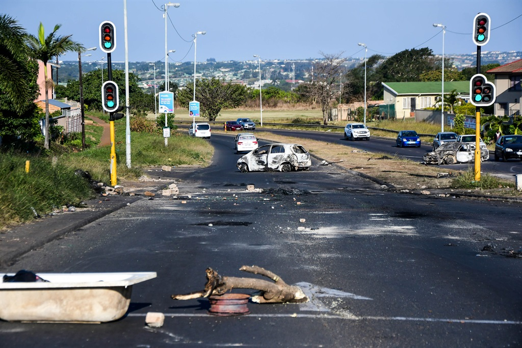 Burnt out cars in Phoenix following violence that engulfed the community on 15 July 2021.