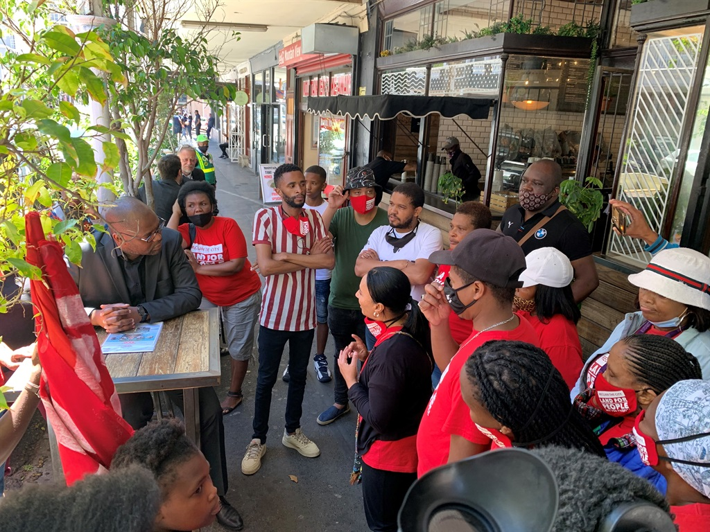 Reclaim the City activists door stop Mayoral Committee member for Human Settlements Malusi Booi in Long Street.