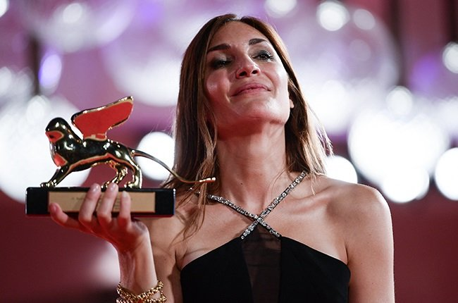 """French director Audrey Diwan poses with the Golden Lion for Best Film she received for """"L'Evenement"""" (Happening)."""