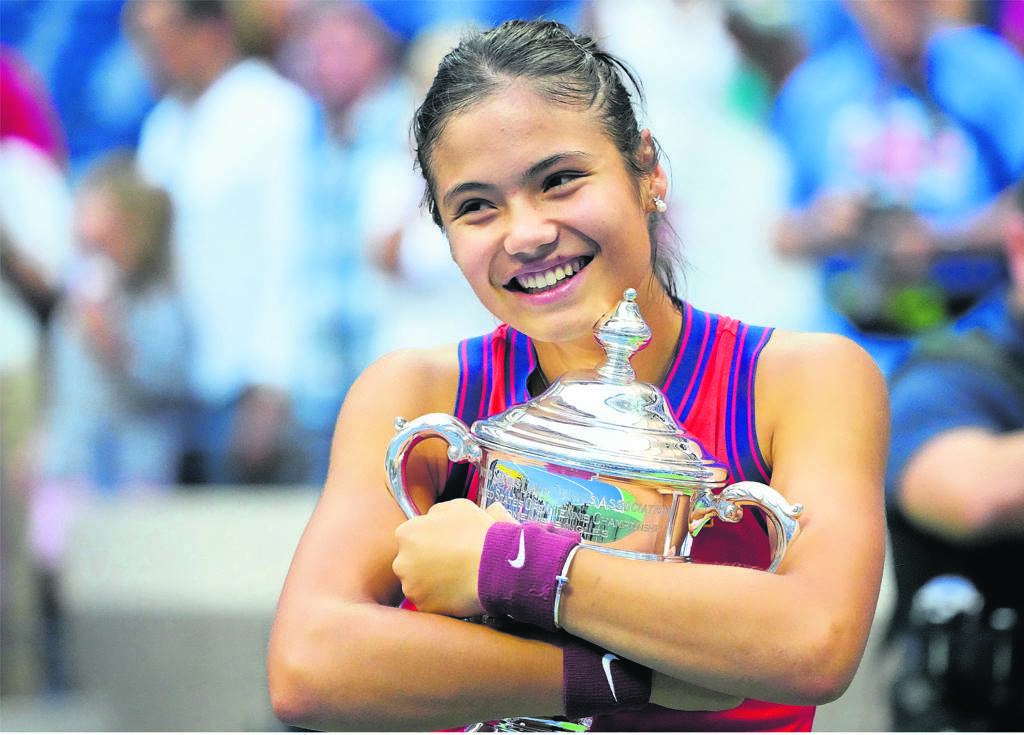 Emma Raducanu holds on tightly to the American Open trophy.