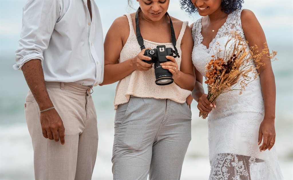 A photographer says she deleted hours worth of photos and walked out on a bridal couple after they refused to let her take a break during their wedding. Illustration photo by Getty Images