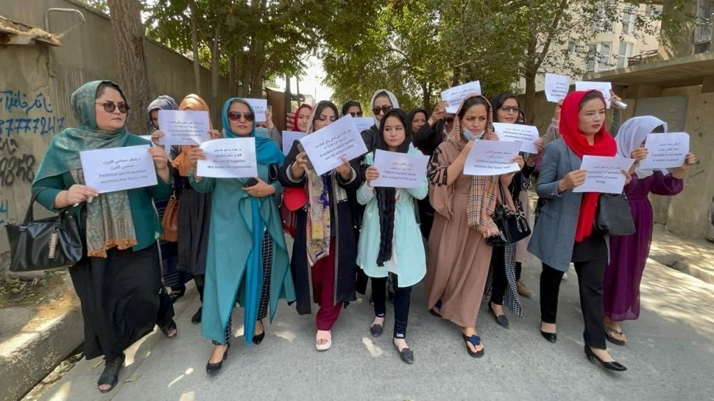 Afghan women activists gathered to protest against Taliban restrictions, who were seen calling for rights and justice in front of the former ministry of women affairs which was setting up as a ministry for the propagation of virtue and the prevention of vice by the Taliban in Kabul. (Photo by Haroon Sabawoon/Anadolu Agency via Getty Images)