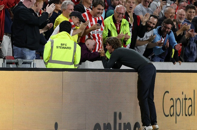 Thomas Frank, manager of Brentford celebrates with a fan after the Premier League match between Brentford and Arsenal at Brentford Community Stadium on August 13, 2021 (Getty Images)