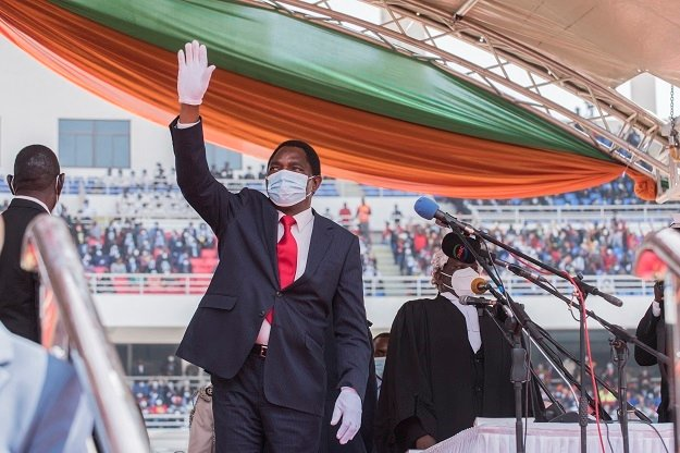 Newly elected Zambia President Hakainde Hichilema waves at the crowd after taking oath of office at the Heroes Stadium in Lusaka.