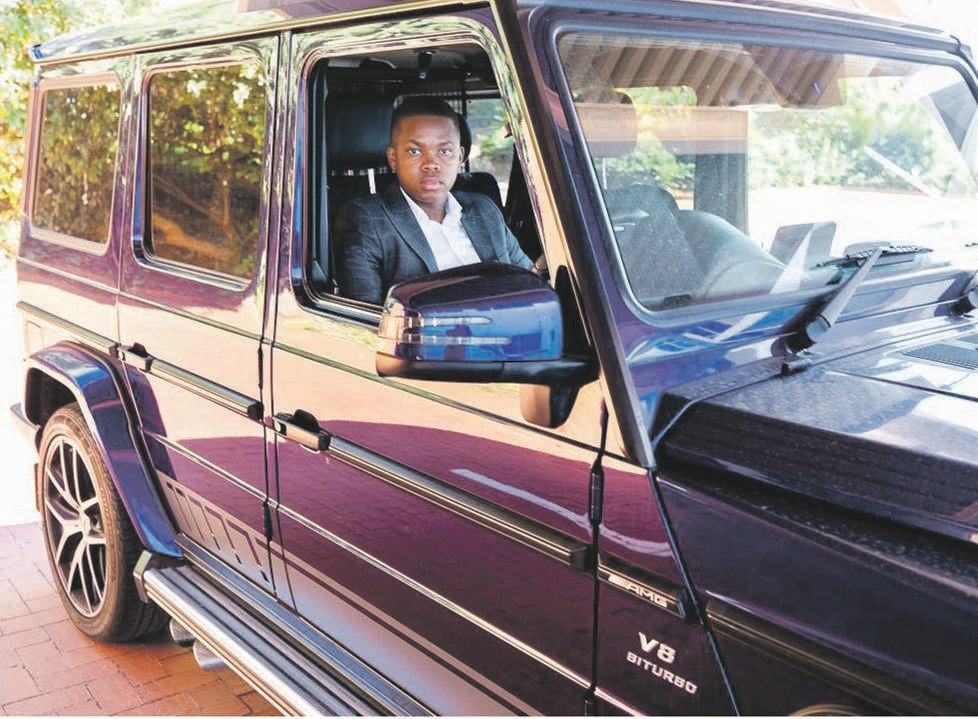 Sandile Shezi with two of his luxury vehicles. He reportedly made millions trading in cryptocurrency. Photo: Facebook