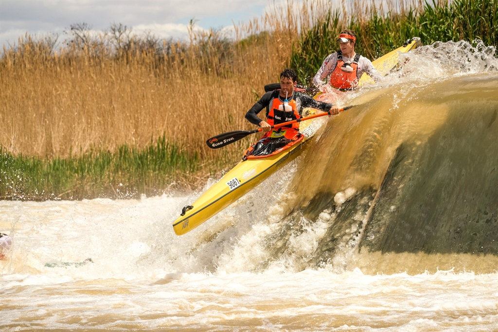 Race winners Andy Birkett and Nick Notten shoot Cradock Weir at the end of the second day of the 2021 Fish River Canoe Marathon on Saturday, October 9. Photo: Bruce Viaene/ Gameplan Media