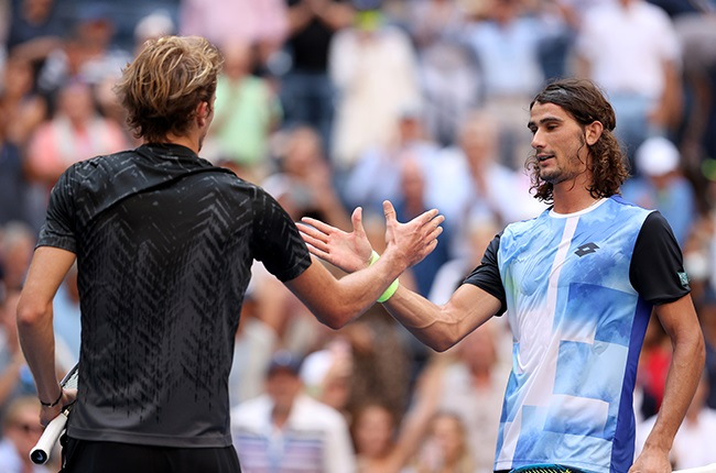 Alexander Zverev and Lloyd Harris shake hands at the net. (Photo by Elsa/Getty Images)