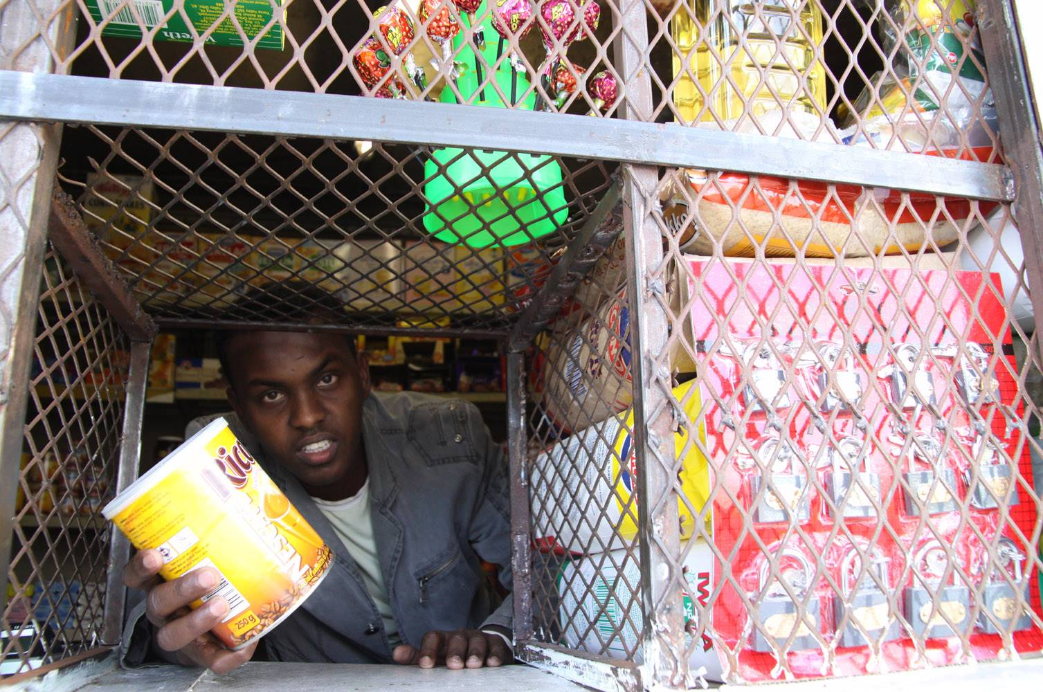 Abdifatah Awes (22) runs a small spaza shop in Gugulethu, Cape Town. SA's informal business sector can collaborate with the formal sector to create an industry that can thrive once again. Photo: Waldimar Pelser