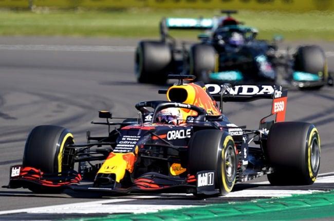 Max Verstappen (front) leading Lewis Hamilton