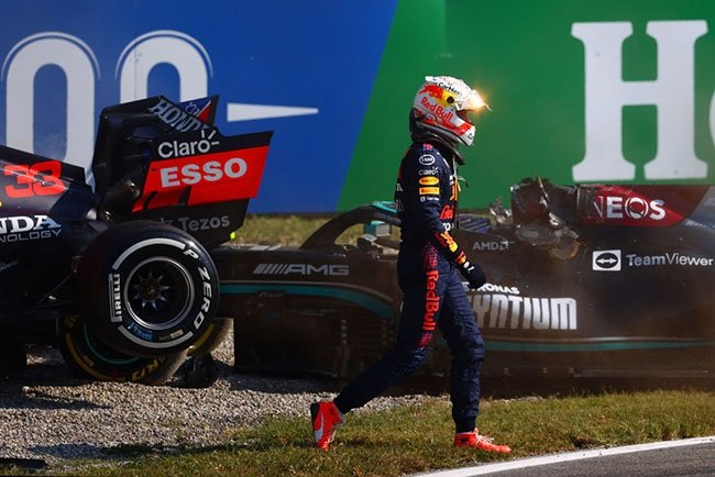 Max Verstappen of Netherlands and Red Bull Racing walks back to the pits after crashing during the F1 Grand Prix of Italy at Autodromo di Monza on September 12, 2021 in Monza, Italy.