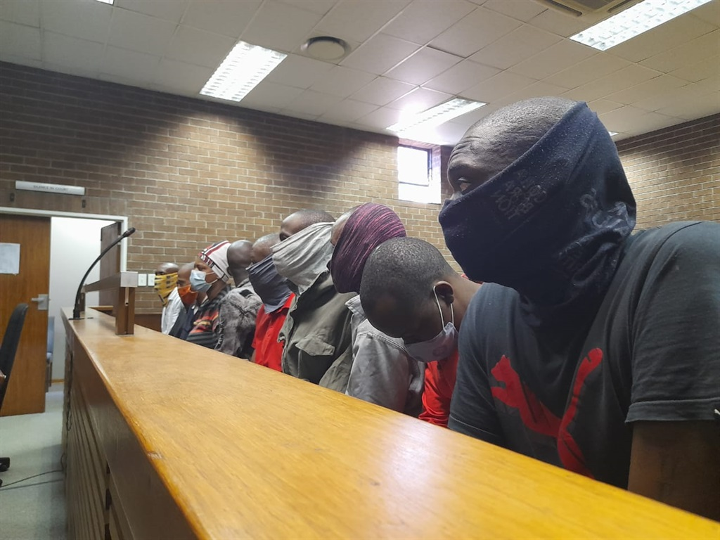Some of the 14 suspects accused of killing eight young men in Zandspruit