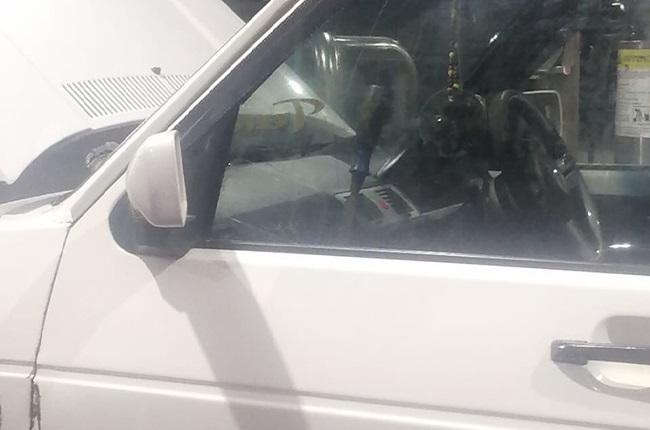 Screwdriver in car window