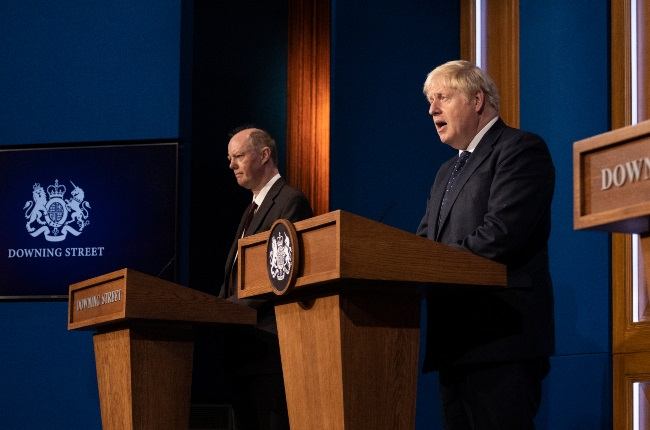 Chris Whitty (left), the UK's chief medical officer, and Prime Minister Boris Johnson tackled the rap superstar's claims at a coronavirus briefing at Downing Street. (PHOTO: Gallo Images / Getty Images)