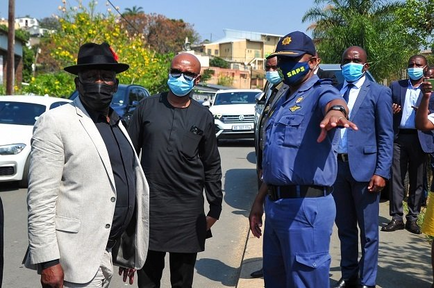 Minister of Police, General Bheki Cele with State Security's Zizi Kodwa at the scene of the crime where three people were killed in Inanda.