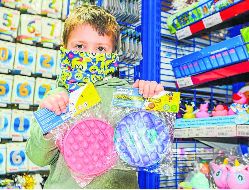 Marco Cronjé (3) with his fidget pop toys.