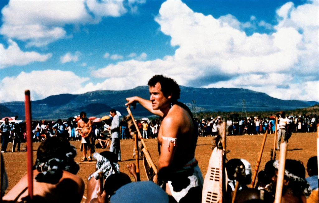 Musician Johnny Clegg prepares to take part in a traditional South African dance in front of a crowd of Zulus. Born in England, Clegg was greatly influenced by Zulu culture and music during his upbringing in South Africa. (Photo by Eric Robert/Sygma/Sygma via Getty Images)