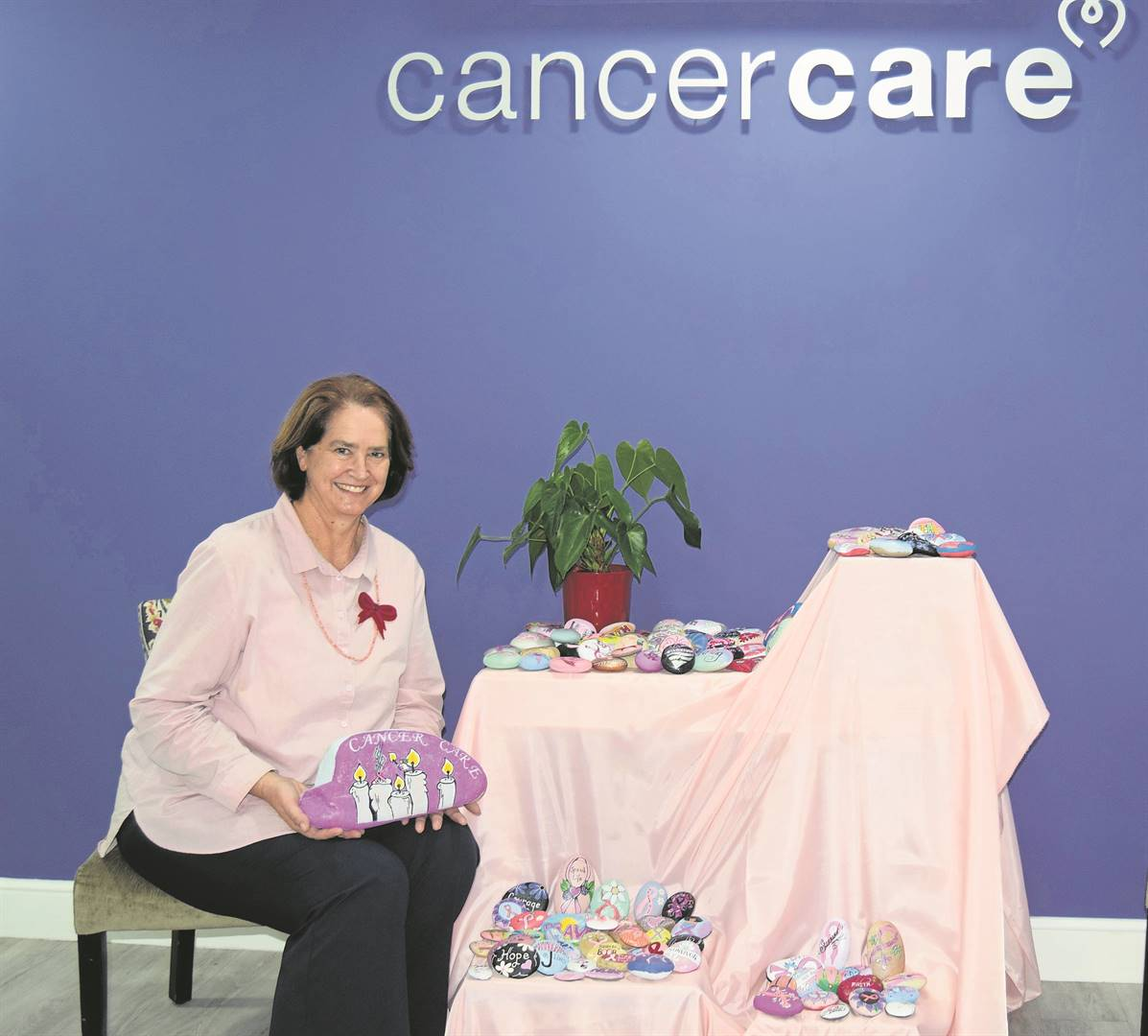 Carin Schultz, social worker at Cancer Care Somerset West, with the large rock painted for the oncology centre.