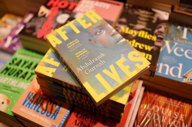 """Copies of """"Afterlives"""" by Tanzanian-born novelist Abdulrazak Gurnah are displayed at Waterstones bookshop in central London on 7 October 2021."""