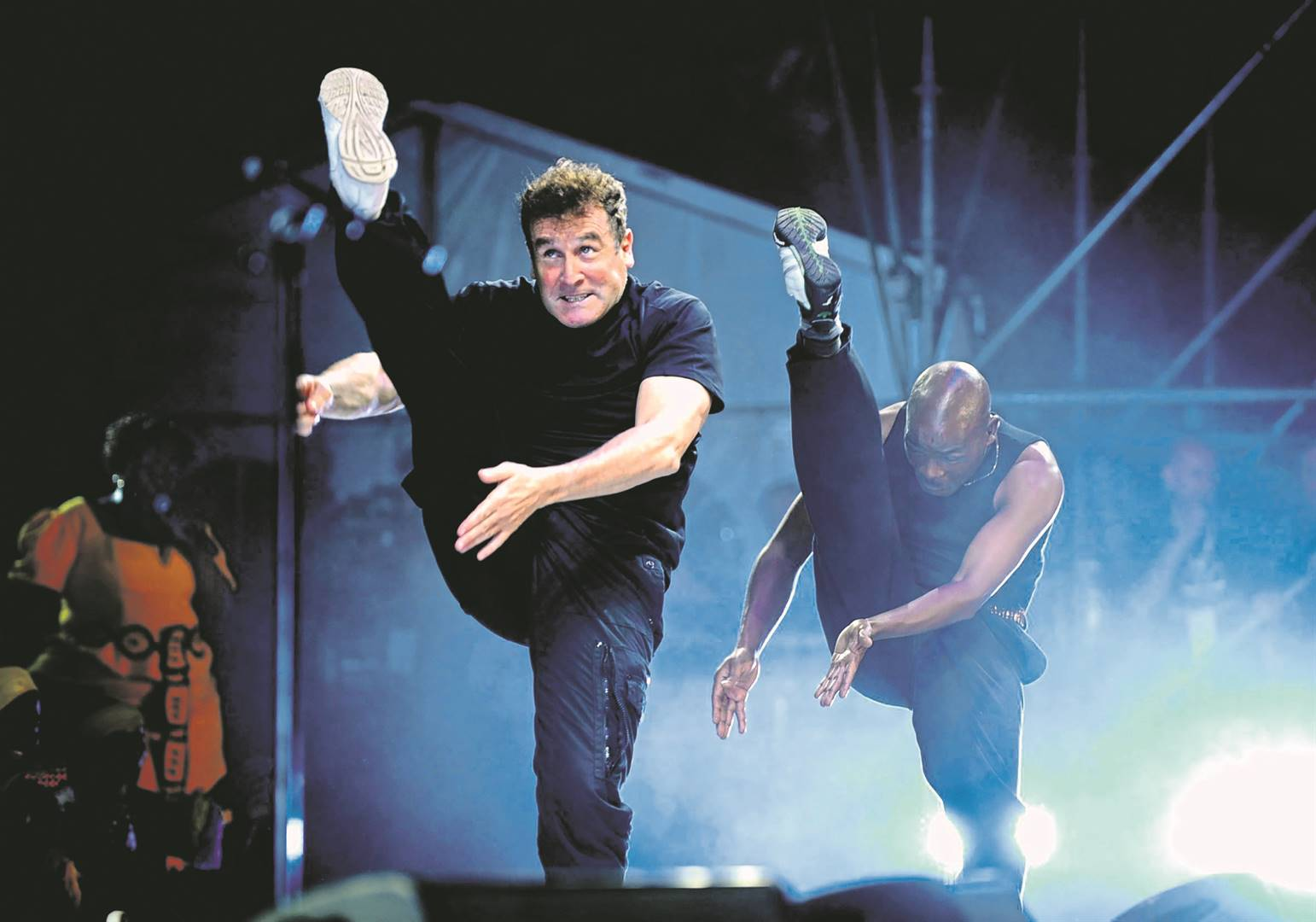 Beneath a copper sun the late musician Johnny Clegg. Photo: gallo images / sunday world / tsheko kabasia and Ebet Roberts / Redferns