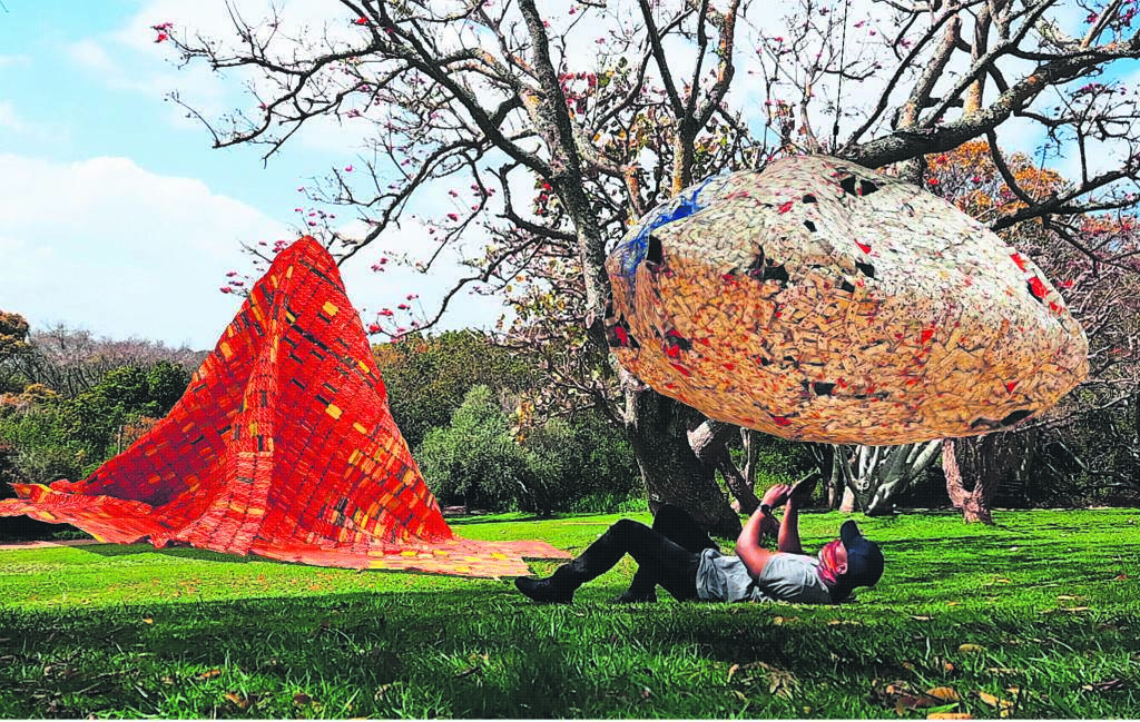 El Anatsui, a sculptor from Western Africa, whose iconic recycled bottle-top installations shimmer gently as though moved by a soft wind.