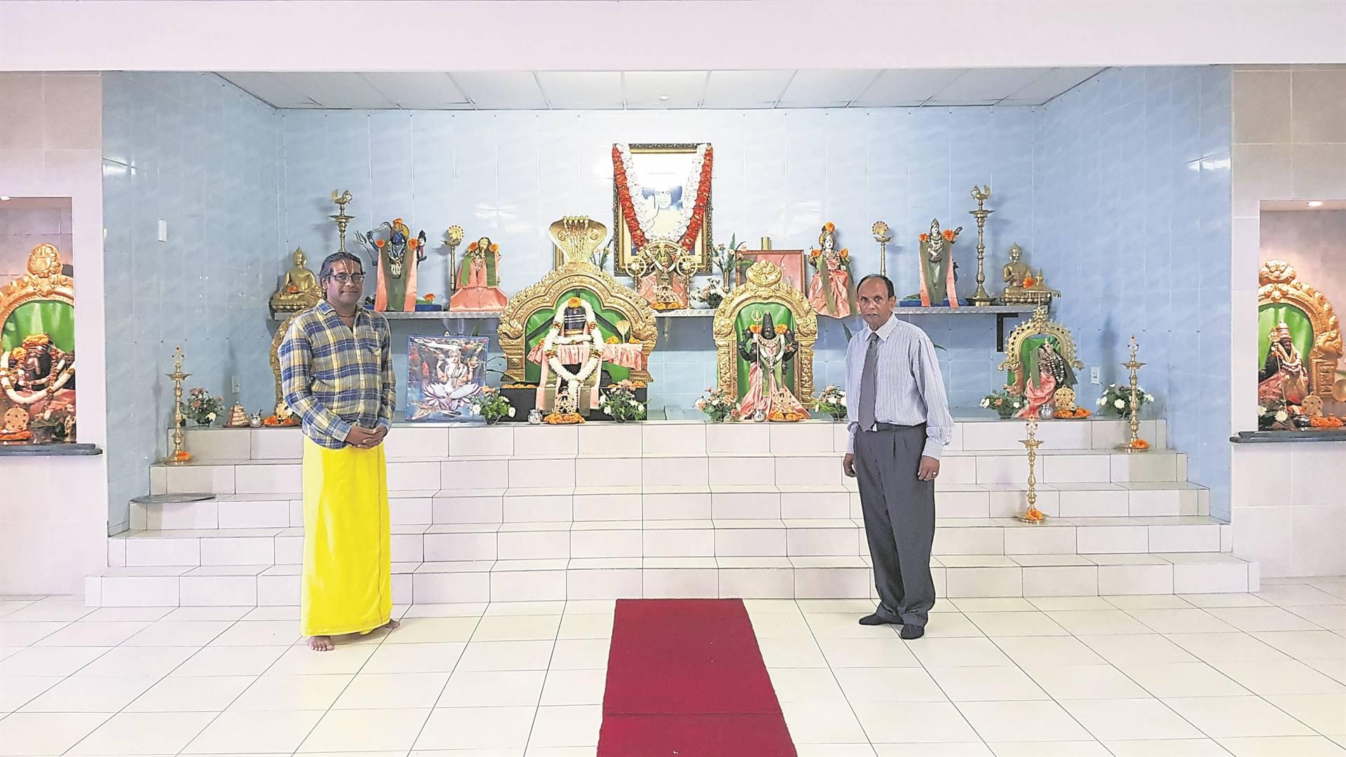 From left: Guru Bhavan and Victor Pillay inside the temple.PHOTO: byrone athman