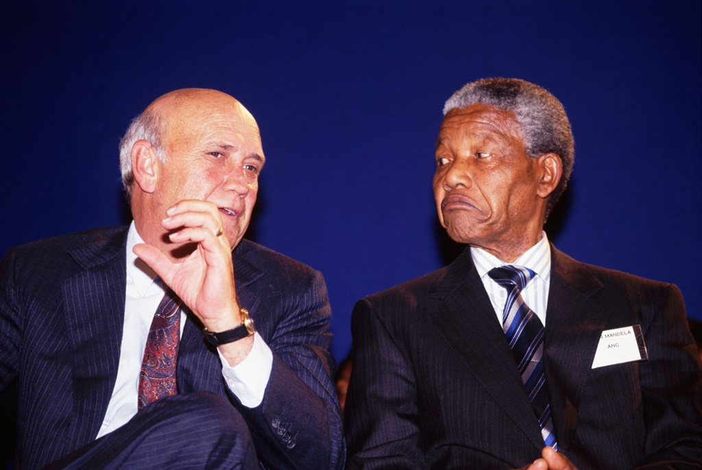 FW de Klerk and Nelson Mandela at a peace signing ceremony during pre-election violence.  (Photo by © Louise Gubb/CORBIS SABA/Corbis via Getty Images)