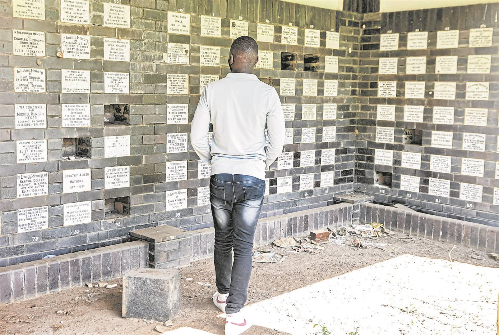 The Mountain Rise Cemetery's cremation niche memorial wall has been left in an appalling state with overgrown grass and a memorial wall being allegedly vandalised by whoonga addicts.
