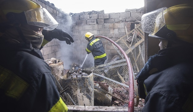 City of Cape Town firefighters douse a blaze.